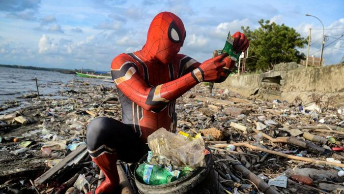 spiderman cleans trash